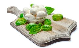 Traditional Italian Mozzarella cheese and basil on white background. Traditional Italian Mozzarella cheese and basil Isolated on white background Royalty Free Stock Images