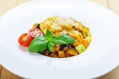 Traditional italian pasta with aubergine and zucchini Stock Photos