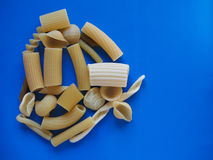 Traditional Italian pasta, blue background with copy space Royalty Free Stock Photo