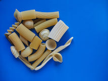 Traditional Italian pasta, blue background with copy space Royalty Free Stock Photos