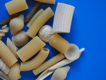 Traditional Italian pasta, blue background with copy space Stock Photos
