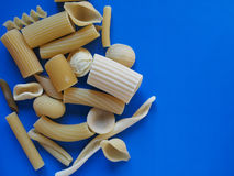 Traditional Italian pasta, blue background with copy space Stock Images