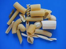 Traditional Italian pasta, blue background Stock Images