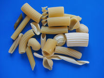 Traditional Italian pasta, blue background Royalty Free Stock Images