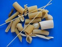 Traditional Italian pasta, blue background Royalty Free Stock Photos