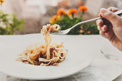 Traditional italian pasta carbonara with bacon and egg on fork Royalty Free Stock Images