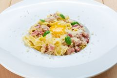 Traditional italian pasta carbonara with bacon and egg Stock Photos