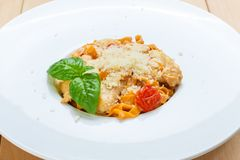 Traditional italian pasta with cured tomato Stock Photos