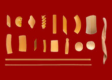 Traditional Italian pasta, dark red background. Many different types of Italian pasta including penne macaroni maccheroni fusilli spaghetti trenette linguine Royalty Free Stock Photography