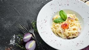 Free Traditional Italian Pasta Dish, Spaghetti Carbonara With Yolk, Parmesan Cheese On A Plate. Royalty Free Stock Image - 168096716