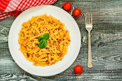 Traditional Italian pasta or fussili with mince. Close-up of traditional Italian spaghetti or fusilli with meat stuff on wooden background Royalty Free Stock Images