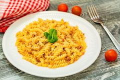 Traditional Italian pasta or fussili with mince. Close-up of traditional Italian spaghetti or fusilli with meat stuff on wooden background Royalty Free Stock Photos