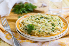 Traditional Italian pasta with garlic and parsley Royalty Free Stock Image