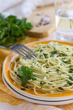 Traditional Italian pasta with garlic and parsley Stock Image