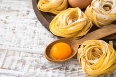 Traditional italian pasta Tagliatelle with ingredients. Homemade. Pasta tagliatelle with eggs Royalty Free Stock Image