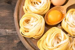 Traditional italian pasta Tagliatelle with ingredients. Homemade. Pasta tagliatelle with eggs Stock Images