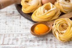 Traditional italian pasta Tagliatelle with ingredients. Homemade. Pasta tagliatelle with eggs Royalty Free Stock Images