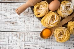 Traditional italian pasta Tagliatelle with ingredients. Homemade. Pasta tagliatelle with eggs Royalty Free Stock Photos