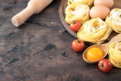 Traditional italian pasta Tagliatelle with ingredients. Homemade. Pasta tagliatelle with eggs Royalty Free Stock Photo