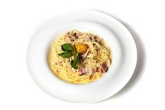 Pasta Carbonara with bacon, basil, egg and cheese. Isolate on white background. Top view royalty free stock photos