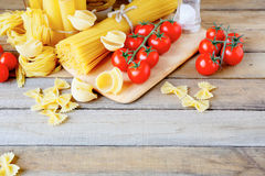 Traditional Italian pasta on wooden tabletop Royalty Free Stock Photos