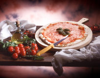 Traditional Italian Pizza. Delicious Pizza Margherita, tomatoes, basil and oil Royalty Free Stock Image