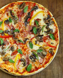 Traditional Italian pizza with mushrooms Royalty Free Stock Photo