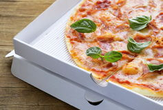 Traditional Italian pizza with prosciutto ham Royalty Free Stock Photography