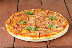 Traditional Italian pizza with prosciutto ham Royalty Free Stock Images