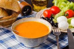 Traditional Italian pumpkin soup, homemade with bread and antipasti stock photo