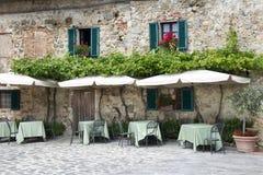 Traditional italian restaurant. In Tuscany - Monteriggioni village Stock Photography