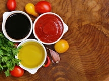 Traditional Italian sauces - balsamic, tomato sauce and olive oil Stock Photos