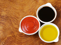 Traditional Italian sauces - balsamic, tomato sauce and olive oil Stock Image