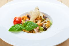 Traditional italian seafood pasta with calamari and mussel Stock Images