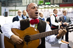 Traditional italian singer at BIT 2012   Royalty Free Stock Image