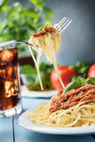Traditional Italian spaghetti bolognese on wooden background Stock Photography