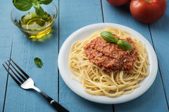 Traditional Italian spaghetti bolognese on wooden background Stock Photos
