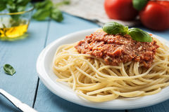 Traditional Italian spaghetti bolognese on wooden background Stock Image