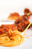 Pasta with pork ribs sauce on polenta bed Royalty Free Stock Images