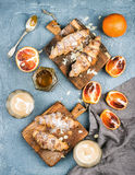 Traditional Italian style home breakfast. Latte in glasses, almond croissants on rustic wooden boards and red bloody Royalty Free Stock Photography