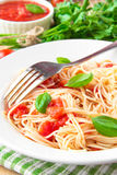Traditional Italian tasty meal pasta with tomato sauce and basil Royalty Free Stock Photography