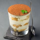 Traditional italian Tiramisu dessert cake in a glass, decorated royalty free stock photos