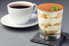 Traditional italian Tiramisu dessert cake in a glass, decorated stock photo