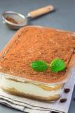 Traditional italian Tiramisu dessert cake in a glass form, decor stock photography