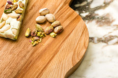 Traditional Italian Torrone. Traditional Italian Christmas Torrone on wooden cutting board Royalty Free Stock Photography