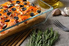 Traditional Italian vegetarian focaccia of homemade bread with olives, rosemary and garlic Stock Images