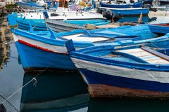 Traditional italian Wooden fishing boats on the old port in Palermo, Sicily. Italy stock photography