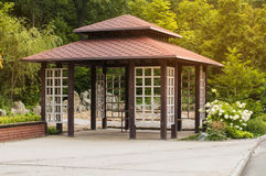 Traditional japan gazebo and flowers. In summer park Stock Images
