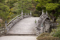 Traditional Japanese arched bridge. An old arched wooden bridge at Kyoto's Imperial Palace, Japan Royalty Free Stock Photo