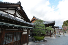 Traditional Japanese Buildings. With Japanese-style roofs, sliding doors, and trees Stock Photo